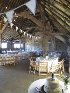 Red Barn - Red-Barn-Interior-beams-and-bunting